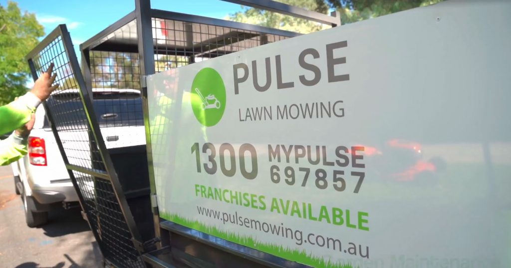 pulse mowing ute and trailer at a house